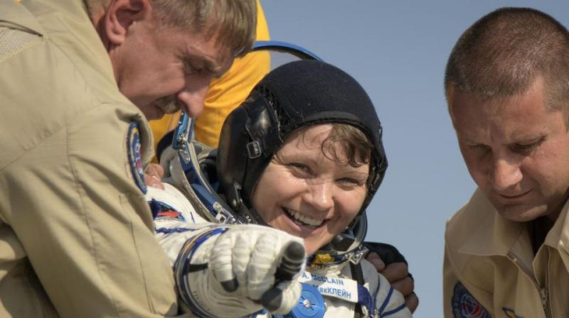 Anne McClain being helped out of the Soyuz MS-11 spacecraft just minutes after she and the other astronauts landed in a remote area near the town of Dzhezkazgan, Kazakhstan. (Photo: AFP)