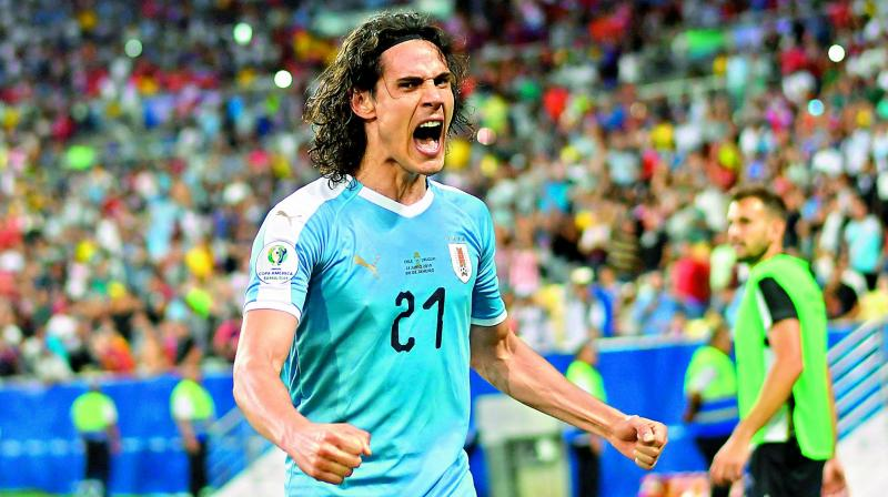 Uruguay's Edinson Cavani celebrates after scoring against Chile during their Copa America group match at Maracana Stadium in Rio de Janeiro, Brazil, on Tuesday. (Photo: AFP)