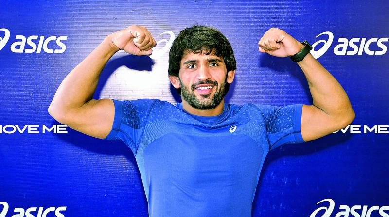 Wrestler Bajrang Punia poses at an event in New Delhi on Tuesday.