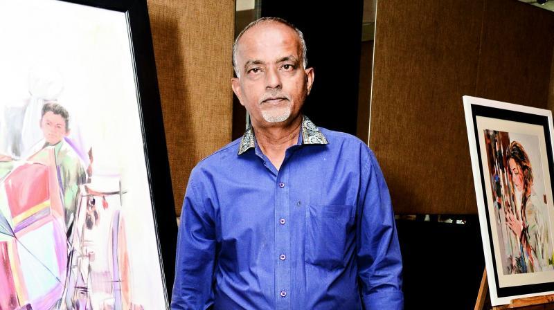Artist Hari Srinivas with his work