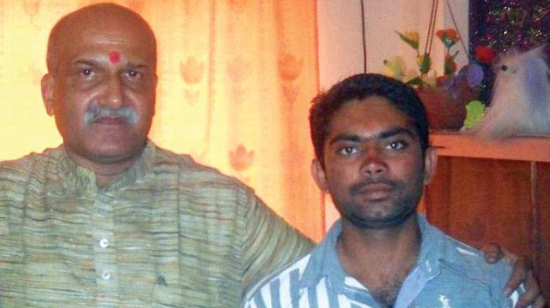 (Left) Pramod Muthalik with Parashuram Waghmare