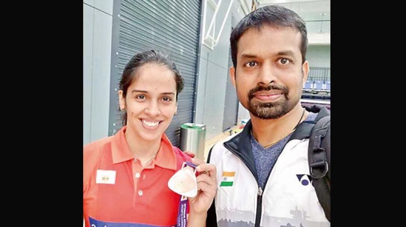 Saina Nehwal is all smiles as she shows her bronze medal in this selfie taken with Gopi at the recent World Championships in Glasgow, Scotland.