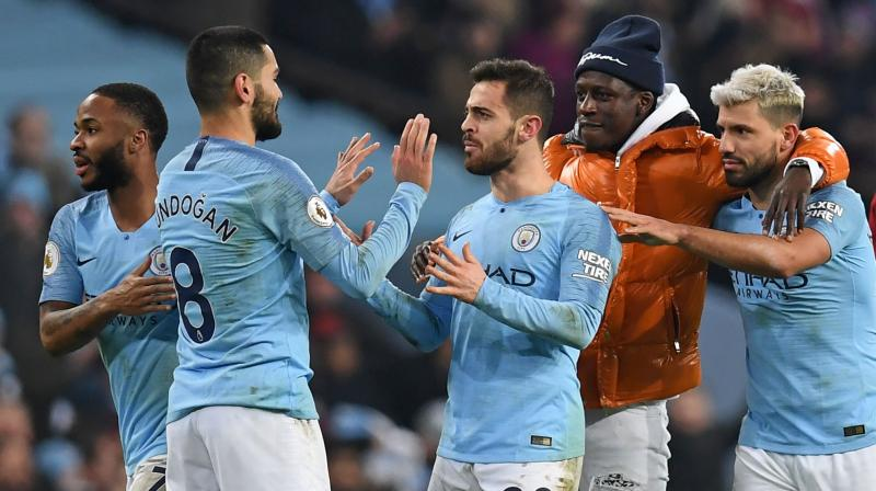 "Manchester City won a ""final"" according to manager Pep Guardiola to remain in the title race by inflicting Liverpool's first Premier League defeat of the season with a 2-1 victory at the Etihad. (Photo: AFP)"