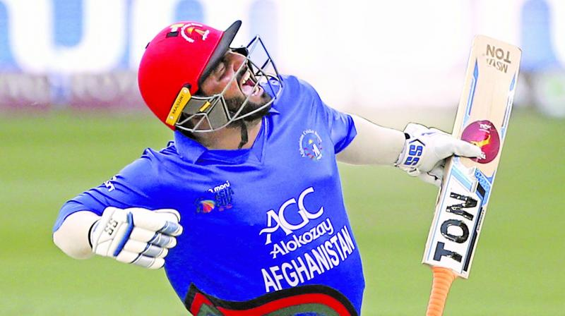 Mohammad Shahzad celebrates his century against India. (Photo: AP)