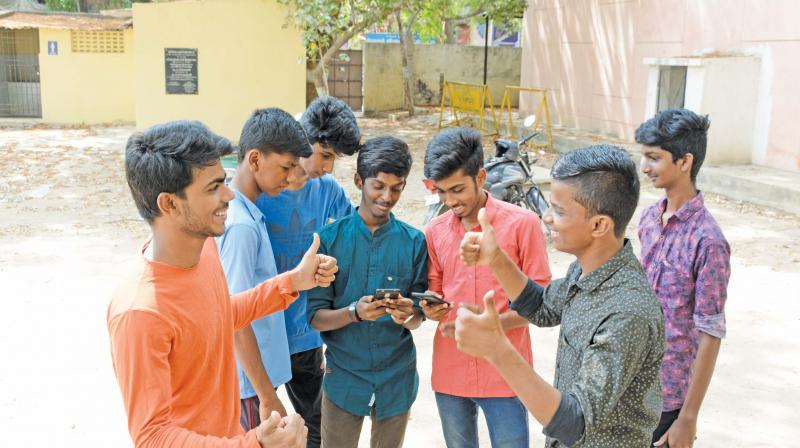 Students of Government Higher Secondary School Adambakkam celebrate after Plus-1 results on Tuesday. (DC)