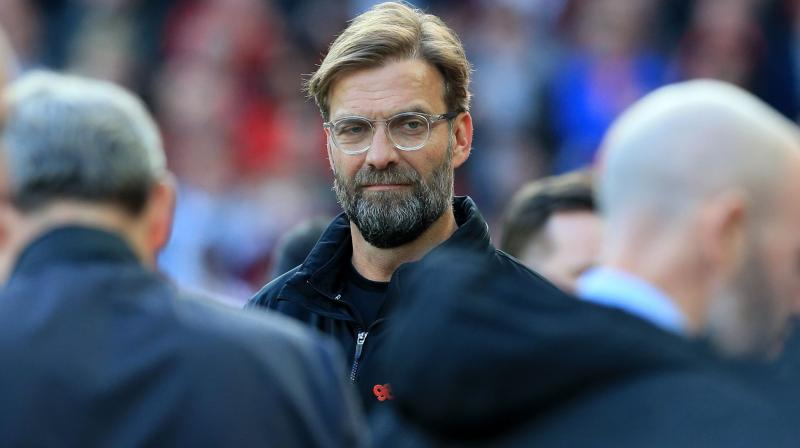 Jürgen Klopp said he wanted to see the same passion and noise from the Liverpool fans inside the ground but better behaviour on the streets outside. (Photo: AFP)