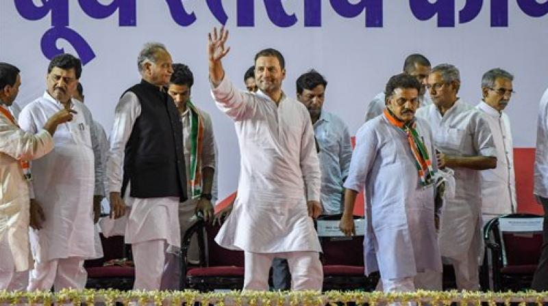 Congress President Rahul Gandhi waves as he arrives to attend a booth level meeting with his party workers, in Mumbai on Tuesday. (Photo: PTI)
