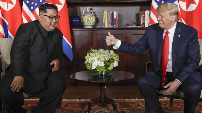 US President Donald Trump said, 'We signed a joint statement that is an unwavering commitment to complete denuclearisation of North Korea.' (Photo: AFP)