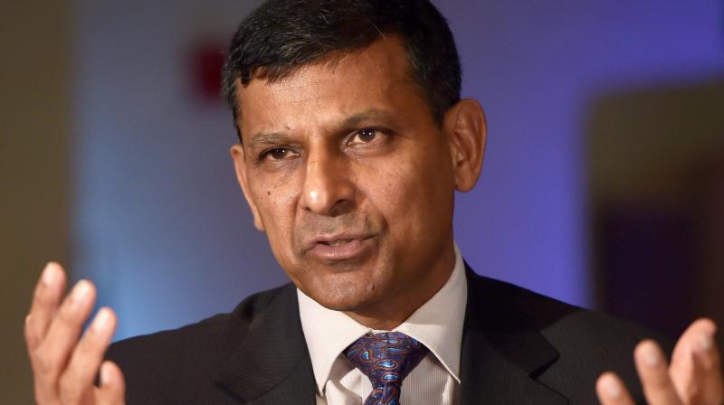 Former RBI Governor Raghuram Rajan lauded the linking of Aadhaar with bank accounts, as a measure of increasing of the tax base. (Photo: PTI)
