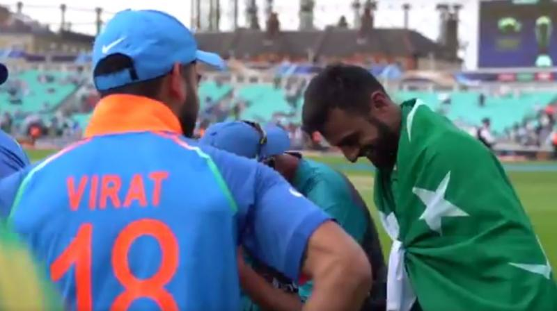 Virat Kohli and Shoaib Malik share a candid moment after Pakistan's 180-run victory over India in the ICC Champions Trophy final. (Photo: ICC/ Screengrab)
