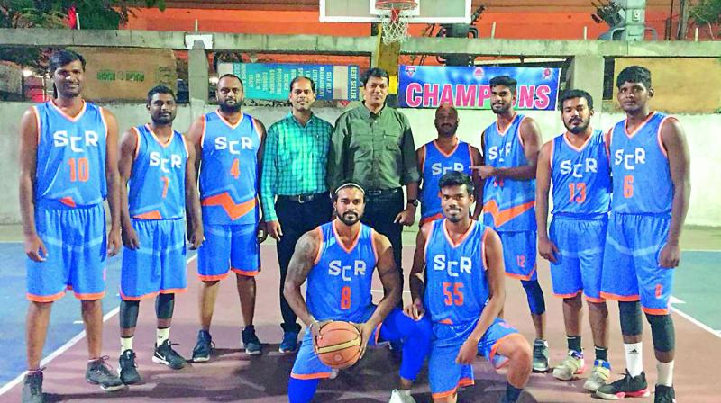 South Central Railway team pose after their 72-71 win over Army Ordinance Corps to clinch the Departments title in the Annual League Basketball Championship in Hyderabad on Monday.