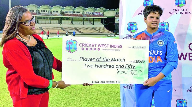 Teenager Shafali Verma (right) collects her Player of the Match cheque for her performance in their first T20 against West Indies on Sunday.(BCCI)