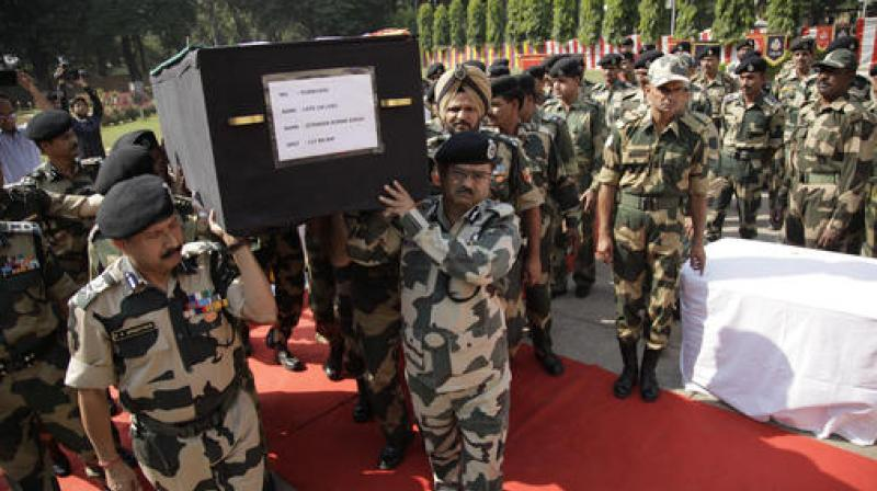 BSF officers carry the coffin of head constable Jitender Kumar Singh, during a wreath-laying ceremony at BSF headquarters in Jammu. (Photo: AP)