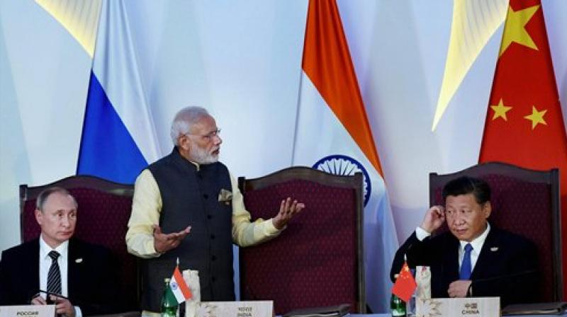 Prime Minister Narendra Modi, Russian President Vladimir Putin and Chinese President Xi Jinping after the press statement during BRICS Summit in Benaulim, Goa. (Photo: PTI)