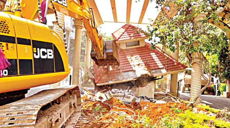 Earth Movers Demolishes Gate Of Classic Orchards On Bannerghatta Road In  Bengaluru On Friday (Photo