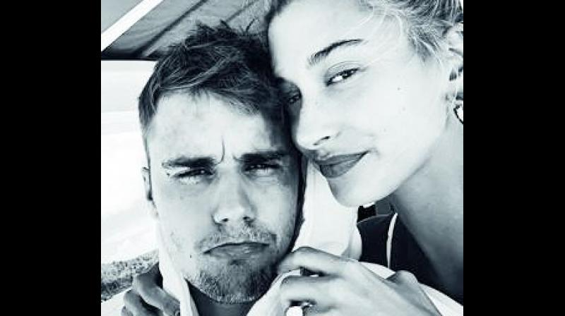 According to www.justjared.com, the 22-year-old model shared a cute selfie of her and her 25-year-old singer husband while on vacation.