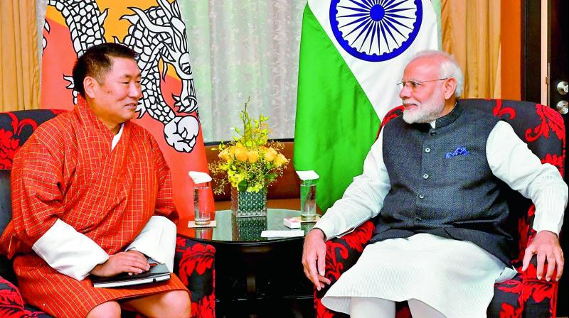 Prime Minister Narendra Modi during a meeting with leader of opposition Pema Gyamtsho, in Thimphu, Bhutan on Sunday. (Photo: PTI)