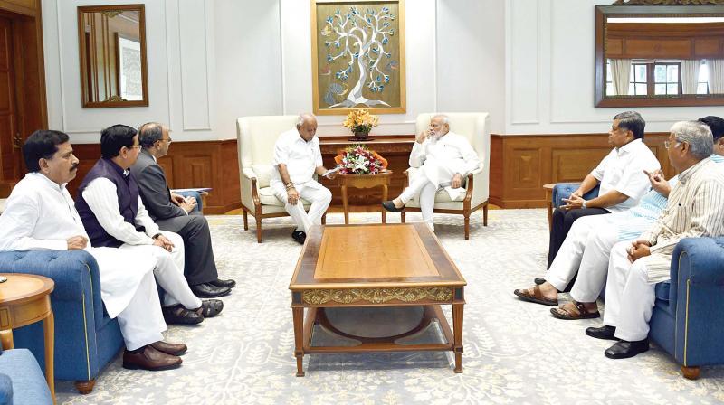 A file photo of CM Yediyurappa with PM Modi.