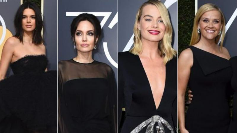 From Left to Right: Kendall Jenner, Angelina Jolie, Margot Robbie and Reese Witherspoon wearing balck at the Golden Globes. (Photo: AP)