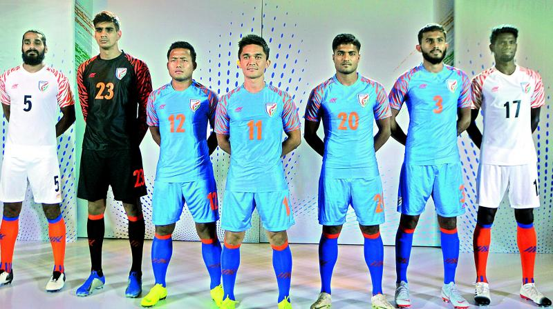 Indian football team captain Sunil Chhetri (centre) is flanked by teammates during the unveiling of the team's new jersey in New Delhi on Wednesday.	— Deccan Chronicle