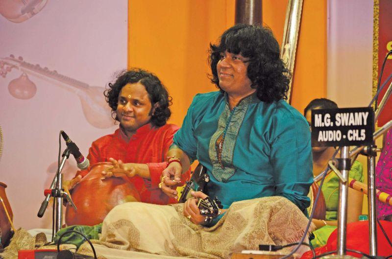 <<<< Mandolin  U. Rajesh  performing  at Parthasarathy Swami Sabha music festival on Wednesday. —DC