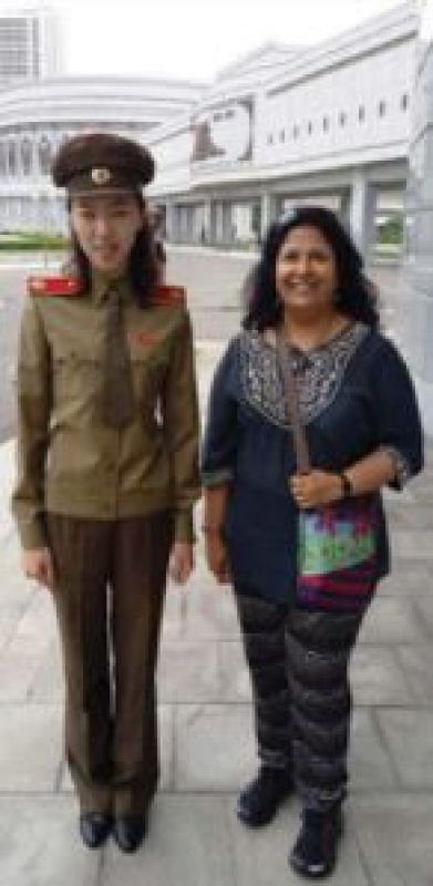 Vibha Jain with a police woman in  North Korea
