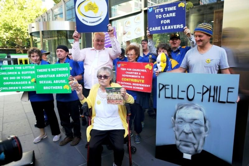 Protesters gathered outside court where Cardinal George Pell was due for a pre-sentencing hearing. (Photo: AFP)