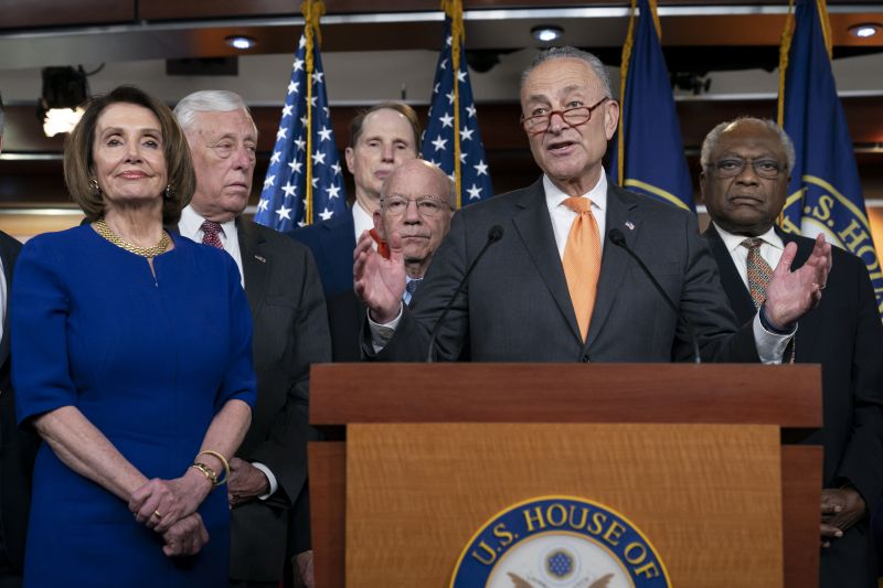 Speaker of the House Nancy Pelosi, D-Calif., left, Senate Minority Leader Chuck Schumer, D-N.Y., center, and other congressional leaders, react to a failed meeting with President Donald Trump at the White House on infrastructure, at the Capitol in Washington, Wednesday. (Photo:AP)