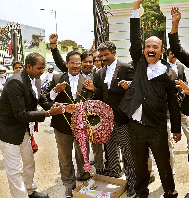 A section of advocates celebrate the clean chit for Yeddyurappa.