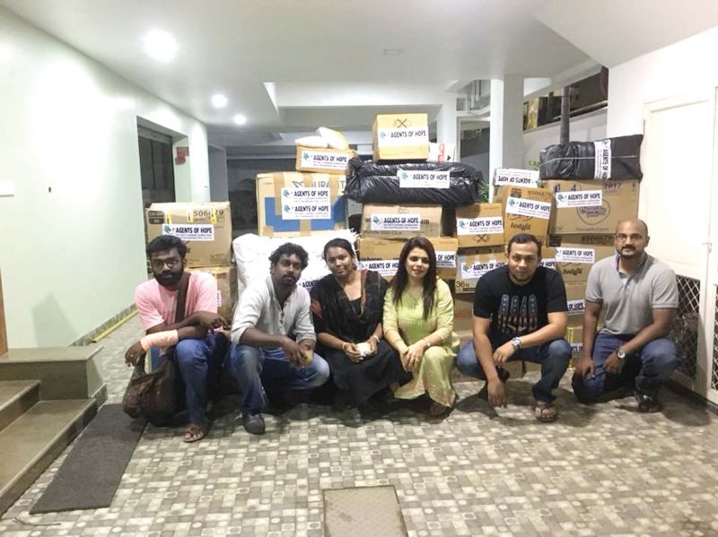 Agents of Hope team with relief materials for the flood affected
