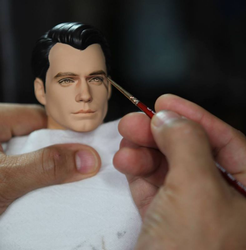 Cruz painting a likeness to Superman (Photo: Facebook)