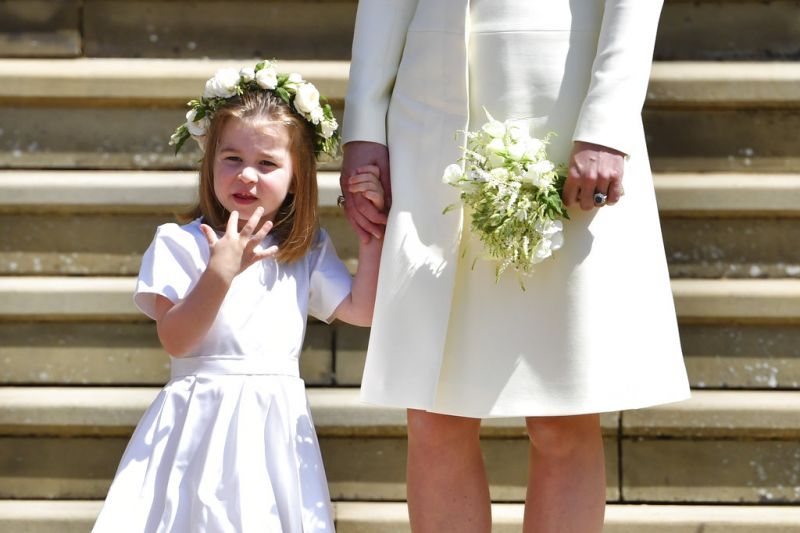 Britain's Princess Charlotte holds the hand of her mother Kate, Duchess of Cambridge. (Photo: AP)