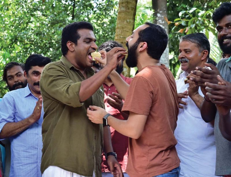 Fahad Fazil (Best Supporting Actor) and Dilesh Pothen (director, Thondimuthalum Driksakshiyum) on the location of a film at Eratuppetta celebrating winning national film awards on Friday.