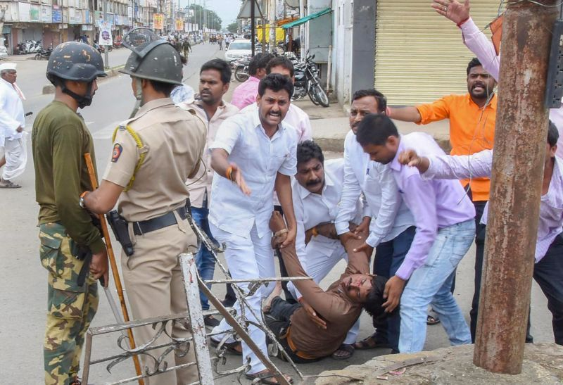 A protester is carried away after being injured during a protest rally demanding reservation for Marathis, in Nanded on Tuesday. (Photo: PTI)