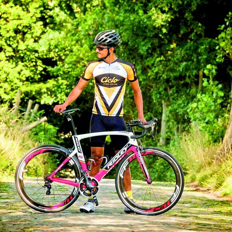 Parashuram Chenji poses with his bicycle.