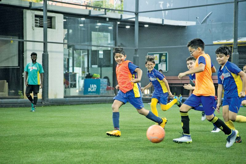 Students of Team Great Goals playing football