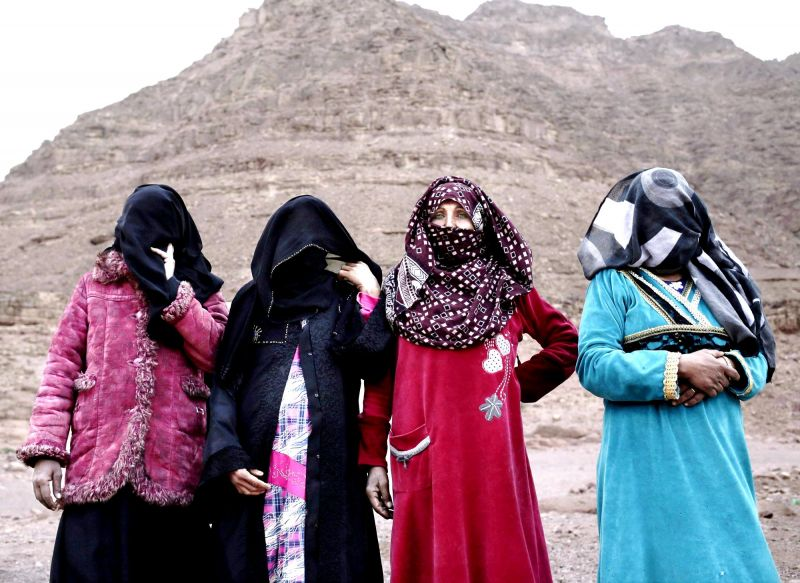 The first female Bedouin guides, from right, Selima, Umm Yasser, Umm Soliman, and Aicha, pose for a photograph in Wadi Sahw, South Sinai, Egypt. (Photo: AP)