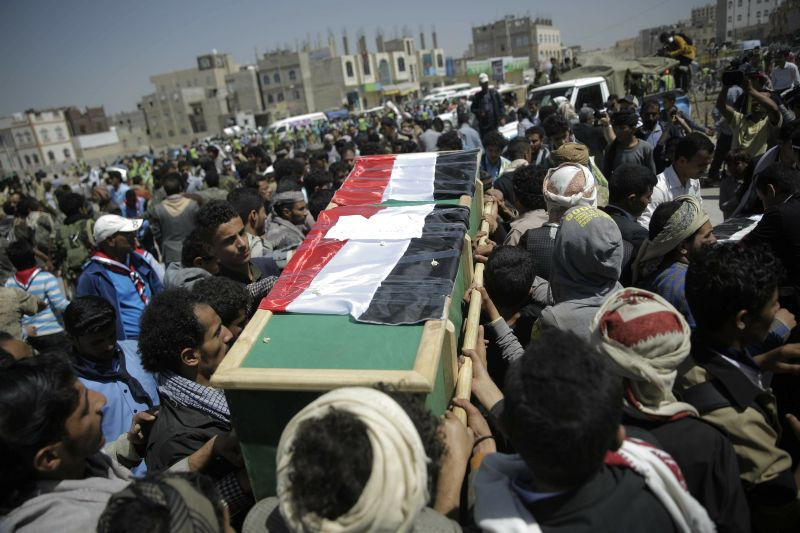 Mourners carry the coffin of a victim of an explosion during a funeral procession in Sanaa, Yemen.