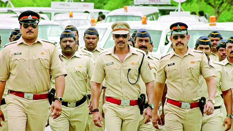 A still from the movie Singham where Ajay Devgn is a cop who fights the bad guys.