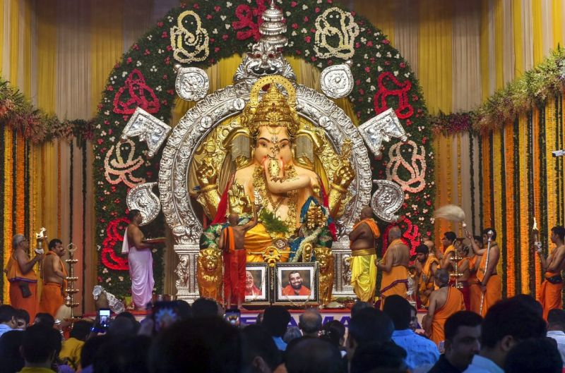 Devotees at the GSB Seva Mandal Ganesh Pandal on the first day of the Ganesh festival in Mumbai. (Photo: PTI)
