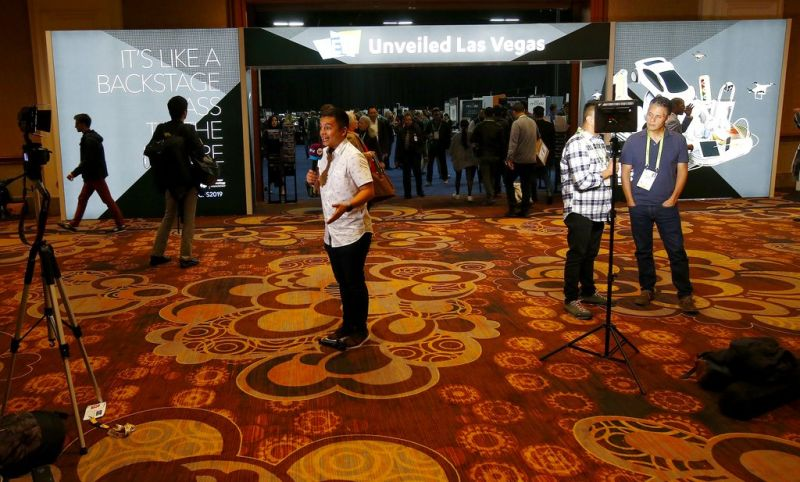 Television reporters do their live standup segments from the entrance at the CES Unveiled at CES International Sunday, Jan. 6, 2019, in Las Vegas. (AP Photo/Ross D. Franklin)
