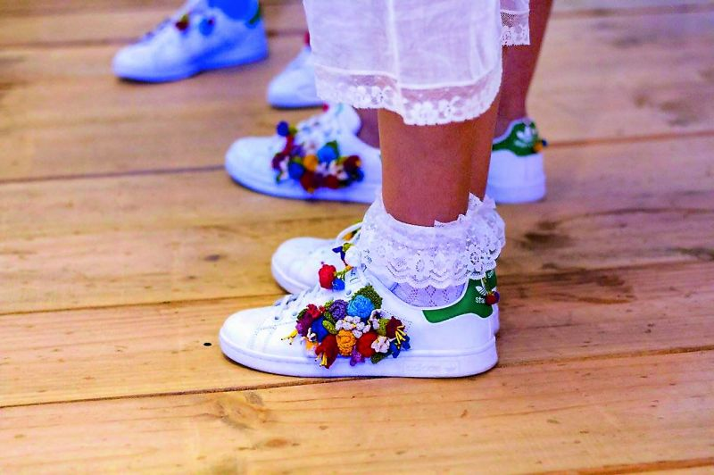 Aneeth Arora worked with Afghan refugees to hand crochet flowers on tennis shoes