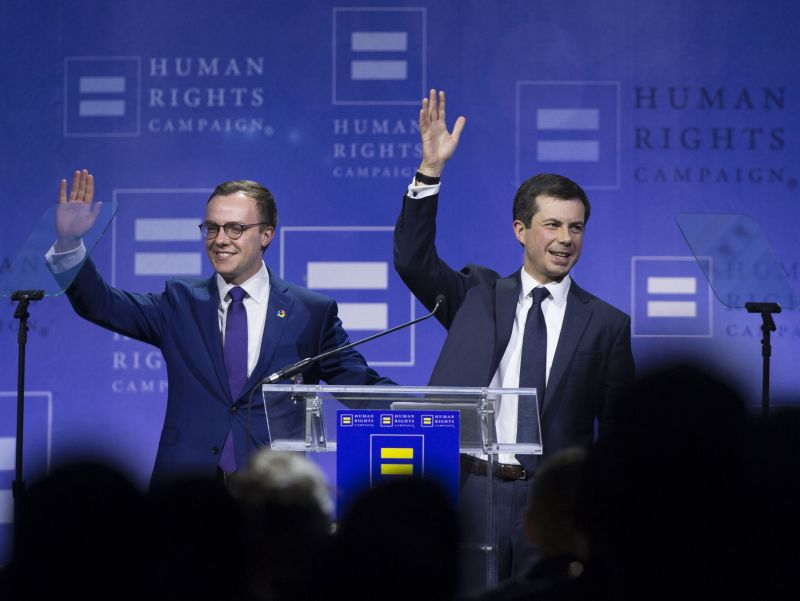 Democratic presidential candidate Pete Buttigieg, right, and husband Chasten Glezman Buttigieg wave to the crowd during the Human Rights Campaign's 14th Annual Las Vegas Gala dinner at Caesars Palace, Saturday, May 11, 2019, in Las Vegas. (Benjamin Hager/Las Vegas Review-Journal via AP)
