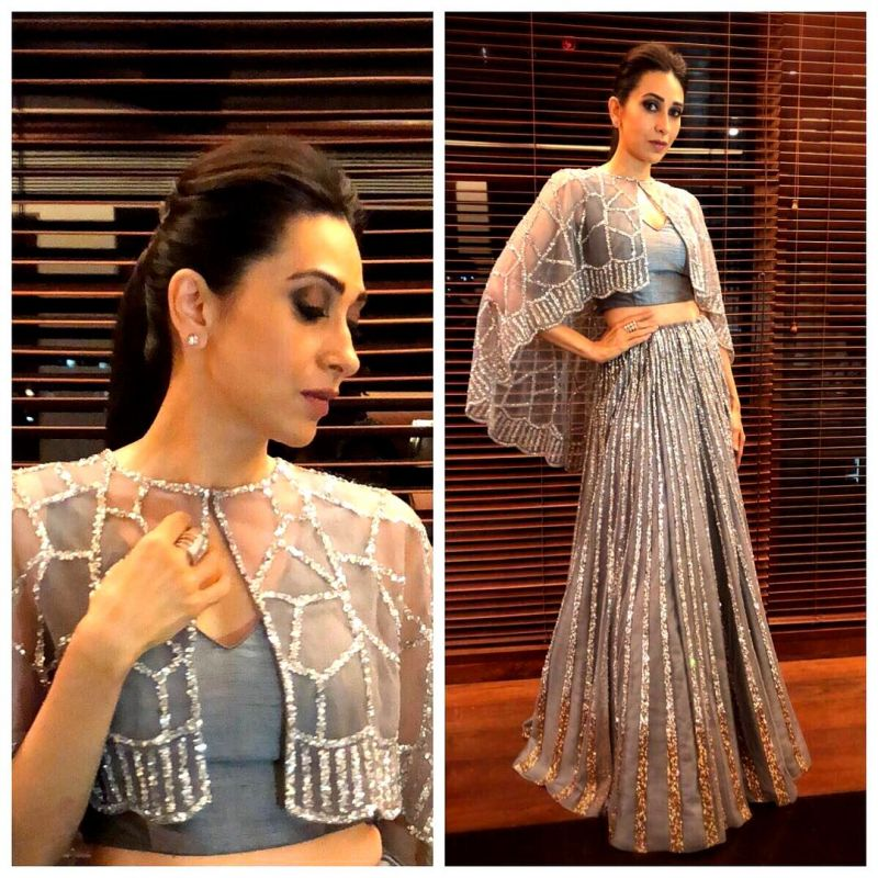 Karisma looking stunning in a grey lehenga cape, embellished with silver shimmer by Neeru's. (Photo: Instagram/ therealkarismakapoor)