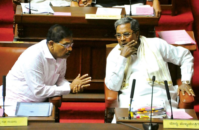 CM Siddaramaiah and Home Minister Dr G Parameshwar in conversation during the Council session