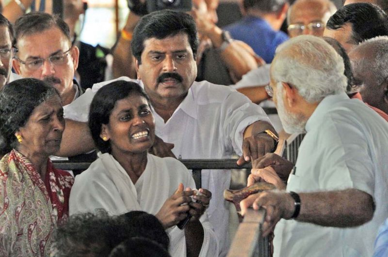 Prime Minister Narendra Modi listens to the woes of a woman during his visit at Poonthura in Thiruvananthapuram
