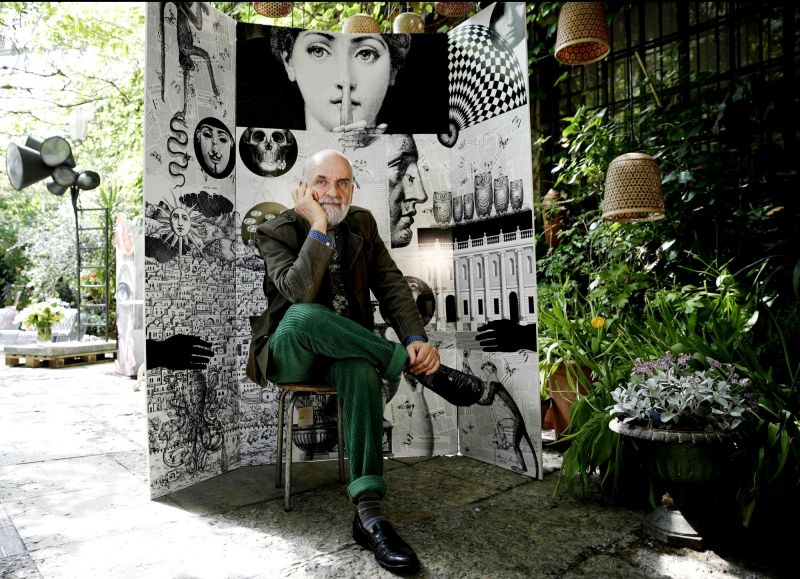 Design artistic director Barnaba Fornasetti poses in front of a paravent folding screen 'Fornasettiana Remix', made with regenerated polystyrene, for the 'RO Plastic - Master's Pieces' exhibition at Milan. (Photo: AP)