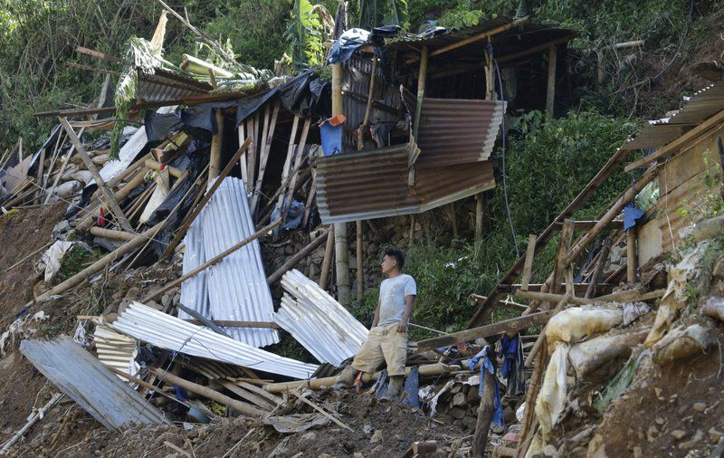 A resident stands beside toppled houses at the site where victims are believed to have been buried by a landslide after Typhoon Mangkhut lashed Itogon, Benguet province, northern Philippines on Monday, September 17, 2018. (Photo: AP)