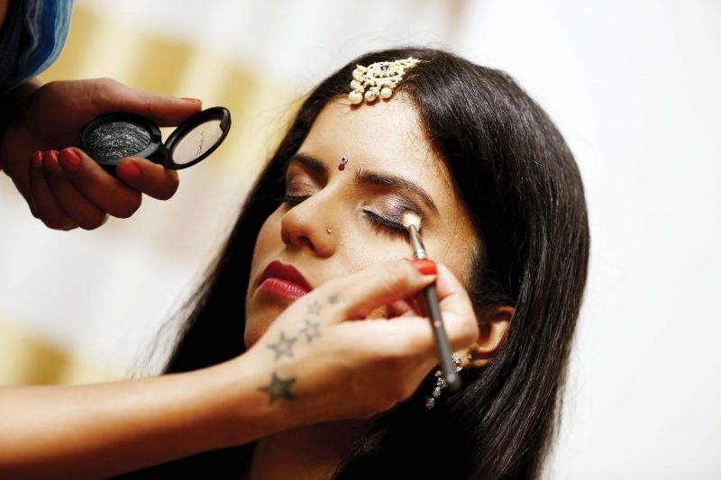 The make-up artist works on a dusky beauty.