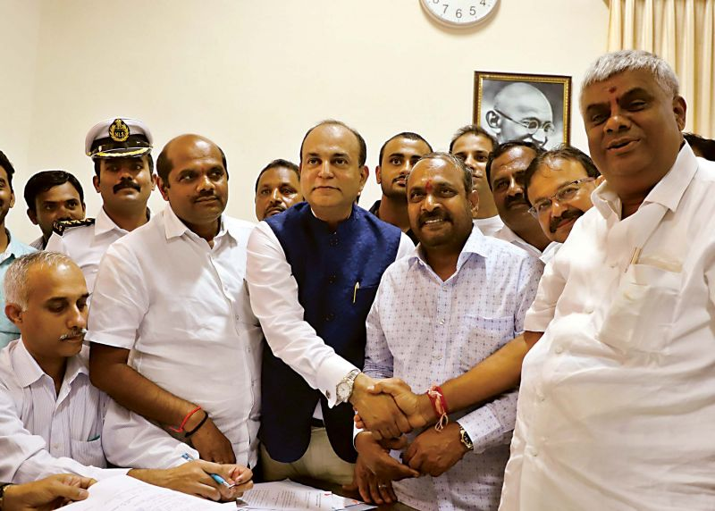 JD(S) candidates B.M. Farook and  Dharme Gowda with party leader H.D. Revanna after filing their nomination papers for Council elections in  Bengaluru on Thursday.